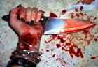 Hand with bloodied blade