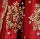 Richly embroidered red silk cloth