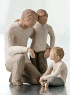Wood carving of a father and his two sons