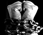 Chains binding two hands together