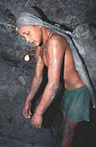 Young slave working in a mine