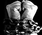 Hands bound with chains
